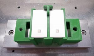 Assembly-line tool 3D printed in ABS, designed to hold switches during production process